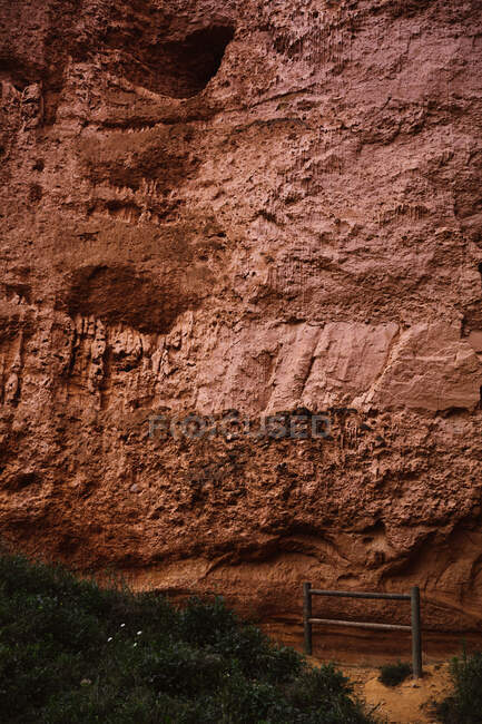 Close up view of stony mountain wall near grass in Cantabria, Spain — Stock Photo