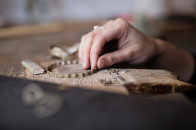 Hand with Tools lying on worktable in workshop — Stock Photo