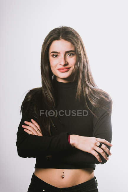 Girl in black turtle neck sweatshirt posing on grey background — Stock Photo