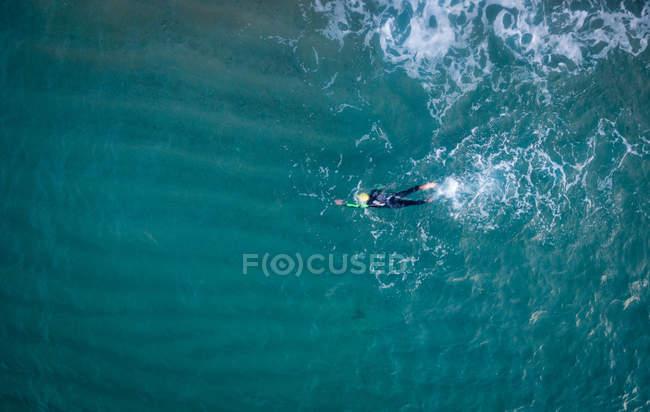 Triathlete training in sea water — Stock Photo
