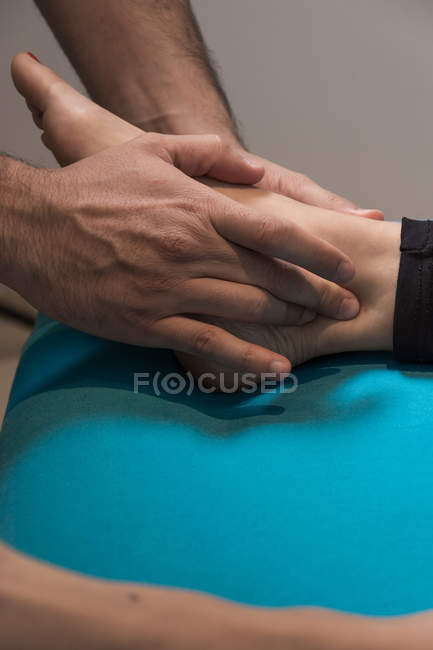 Close-up of therapist massaging female hand — Stock Photo