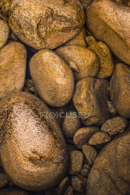 Top view of pile of big rough brown stones. — Stock Photo