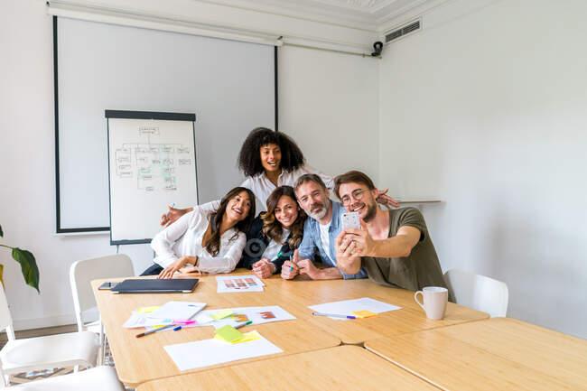 Business team taking selfie — Stock Photo