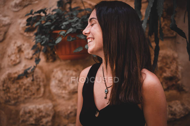 Smiling woman near old building — Stock Photo