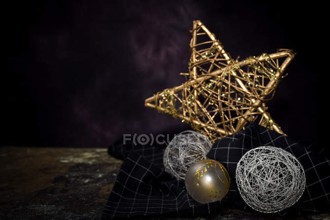 Christmas gold and silver ornaments on dark background — Stock Photo