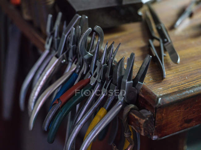 Close-up of different metal tools at wooden table — Stock Photo