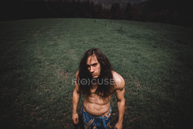 Attractive shirtless man standing in beautiful green valley of Andorra — Stock Photo