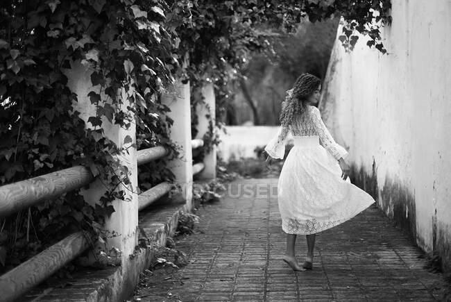 Beautiful young woman in white dress — Stock Photo