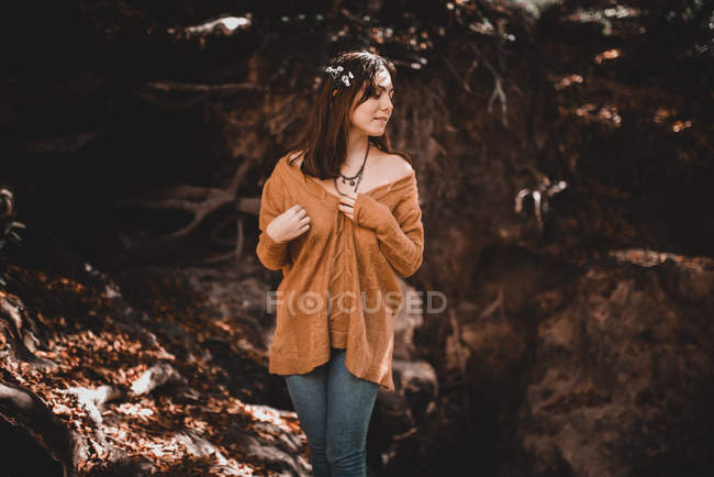 Lovely woman near forest creek — Stock Photo