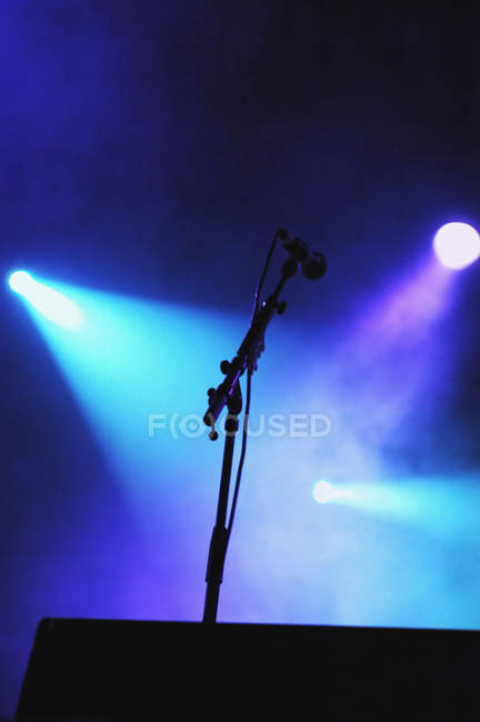 Closeup of microphone on illuminated music stage — Stock Photo