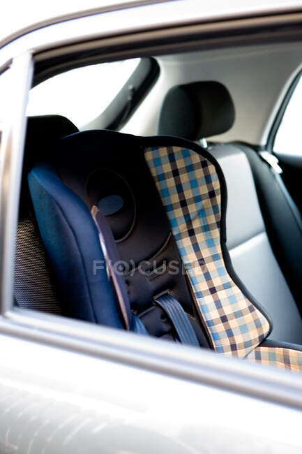 View of modern booster chair placed on back seat in modern car — Stock Photo