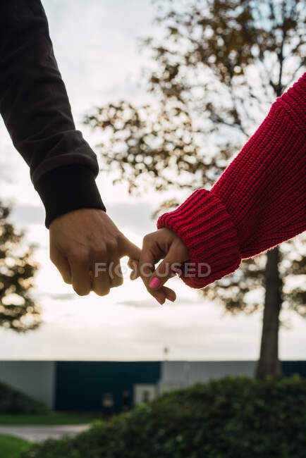 Crop man and woman holding hands — Stock Photo