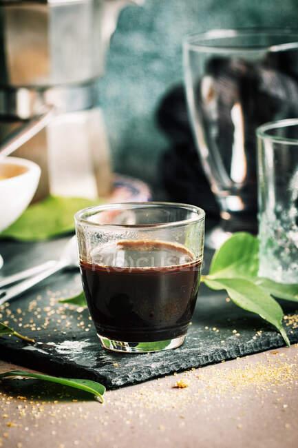 Crystal glass of coffee — Stock Photo