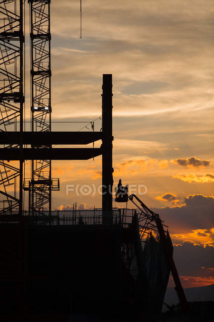 Silhouette of construction site on sunset background — Stock Photo