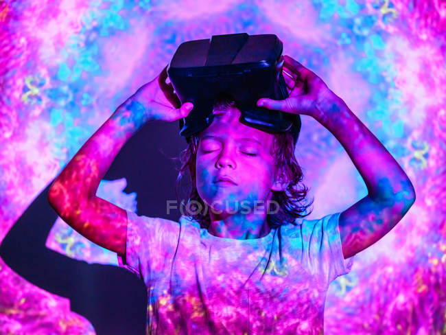 Focused boy with VR glasses under projection — Stock Photo