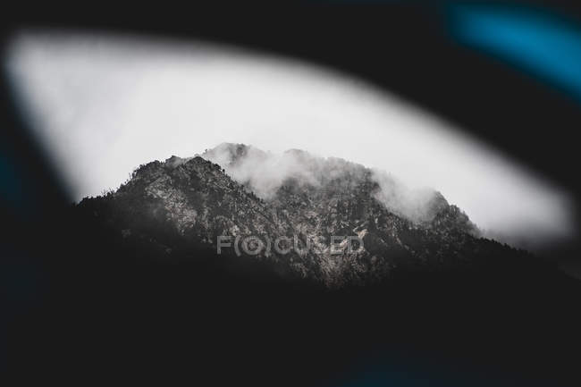 Beautiful view of soft clouds floating over mountain peak in Andorra — Stock Photo