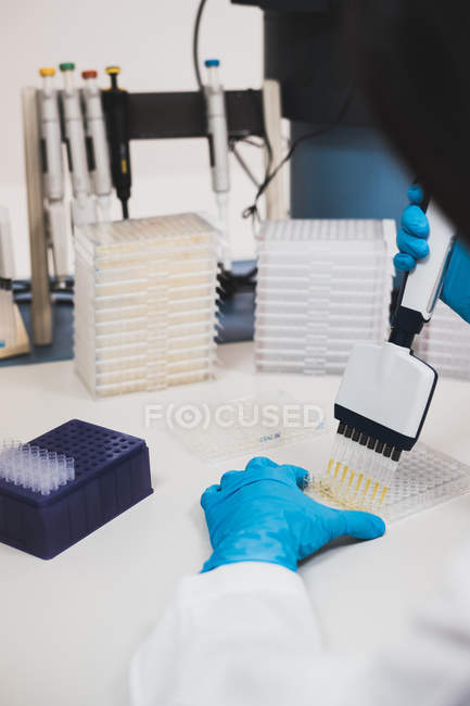Close-up of person using laboratory equipment — Stock Photo