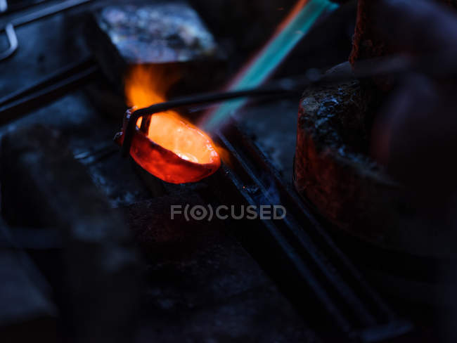Close-up of metal heating on jewelry factory — Stock Photo
