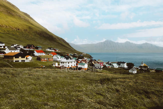 View to small village with colorful houses and green mountains on Feroe Islands — Stock Photo