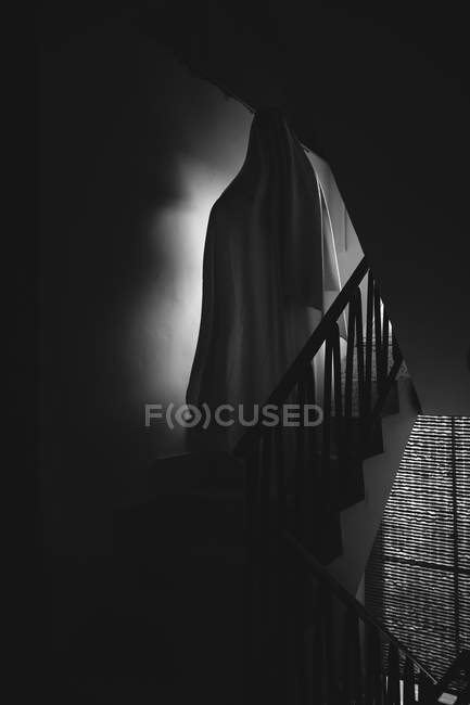 Person disguised as ghost for Halloween in dark room — Stock Photo