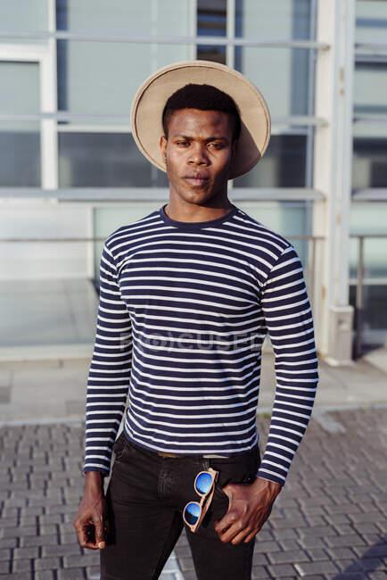 Stylish black man posing on street — Stock Photo