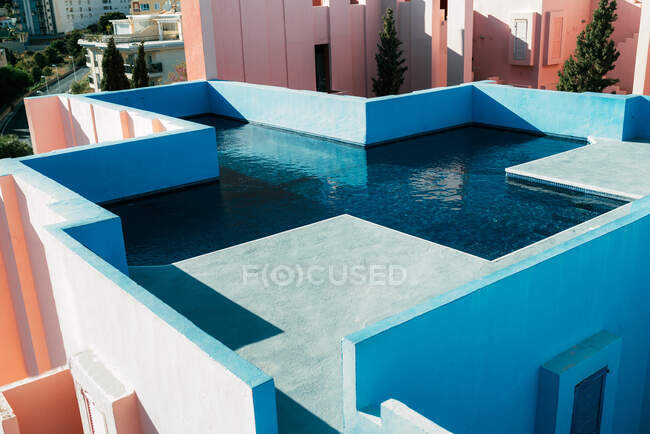 Modern architecture of a blue building swimming pool cross shape — Stock Photo