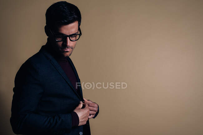 Young business man in a studio — Stock Photo