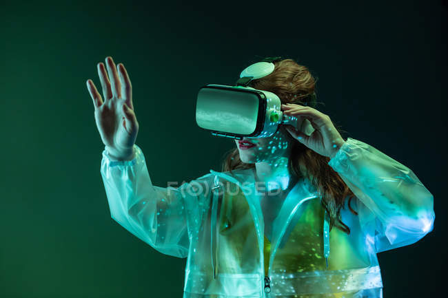 Woman wearing VR glasses in neon light — Stock Photo