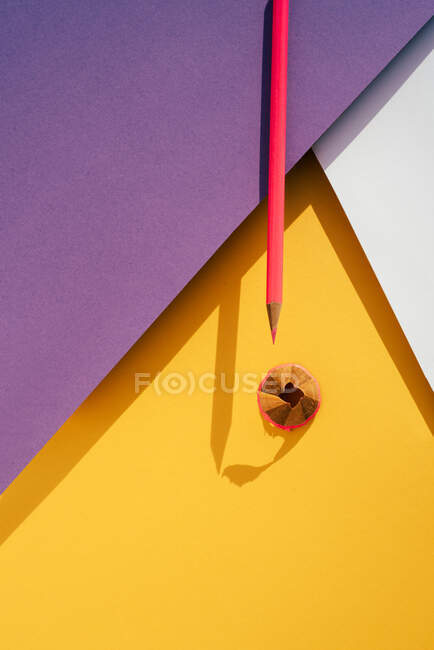 Back to school, modern geomeric background, pink Pencil and shavings from sharpening. — Stock Photo