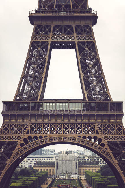 Basement of Eiffel Tower with cityscape on background, Paris, France — Stock Photo