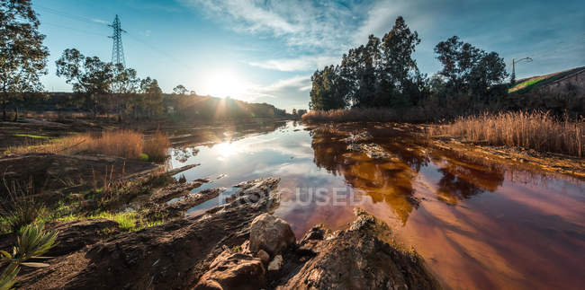 Calm water of pond reflecting surroundings of bright countryside in sunshine, Spain — Stock Photo
