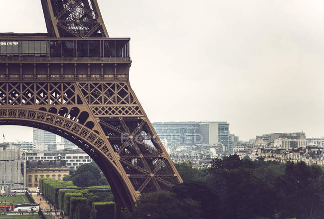 Part of Eiffel Tower on background of cityscape of Paris, France — стоковое фото