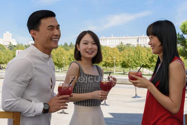 Asian people drinking yummy beverage — Stock Photo