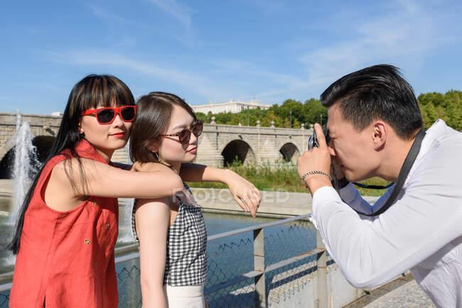 Man taking photo of Asian women — Stock Photo