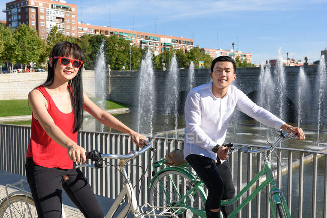 Asian people with bicycles — Stock Photo