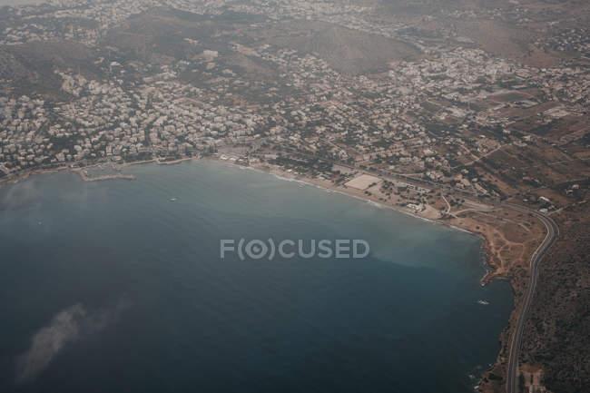 Von oben Ansicht der Stadt an der Küste der Insel Mykonos — Stockfoto