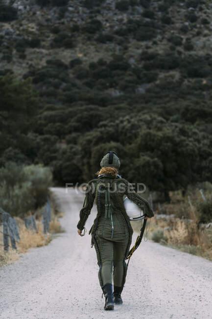 Beautiful woman walking dressed as an astronaut. — Stock Photo