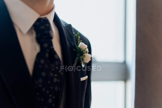 Crop groom in elegant tie and suit — Stock Photo