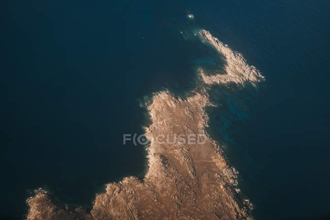 Aerial view of rocky seashore with dark blue sea in Mykonos — Stock Photo