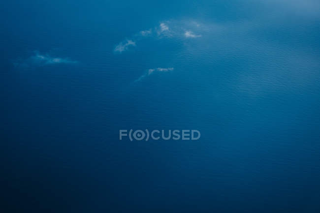 Aerial view of azure waving water surface — Stock Photo