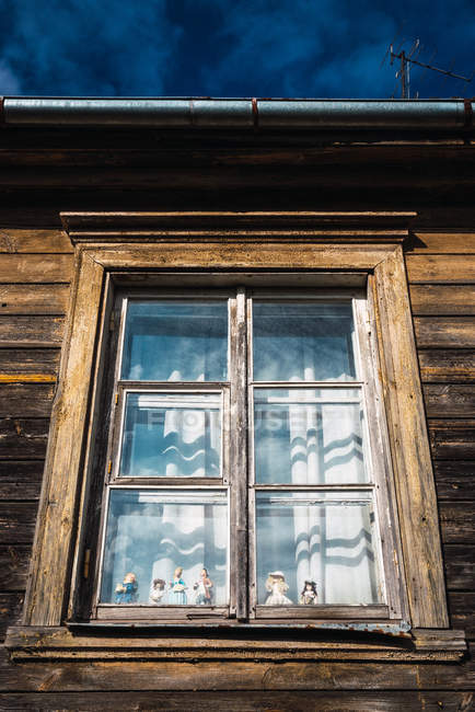Window of old wooden building in countryside — Stock Photo