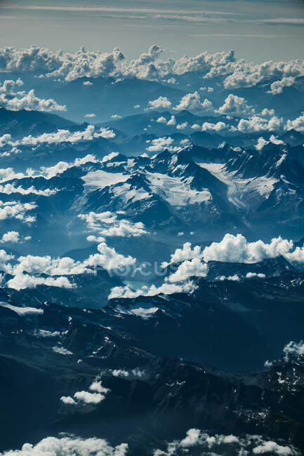 View on mountain and clouds from plane — Stock Photo