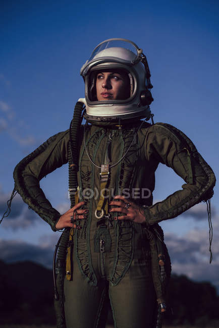 Confident female astronaut standing in nature in evening — Stock Photo