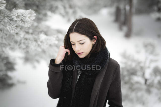 Young female in warm clothes walking on windy winter day in magnificent countryside — Stock Photo