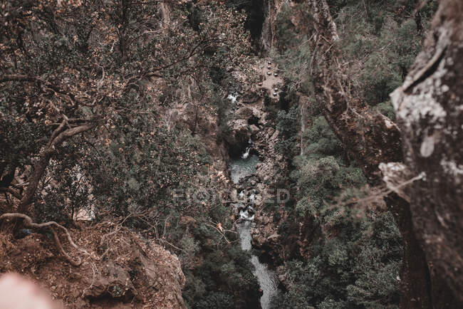 From above small cascade falling to tiny lake in gorge in Morocco — Stock Photo