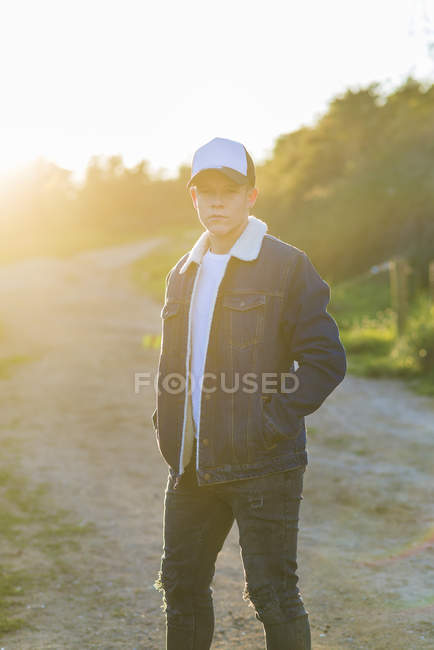 Portrait of a young teenager outdoors wearing casual attire — Stock Photo