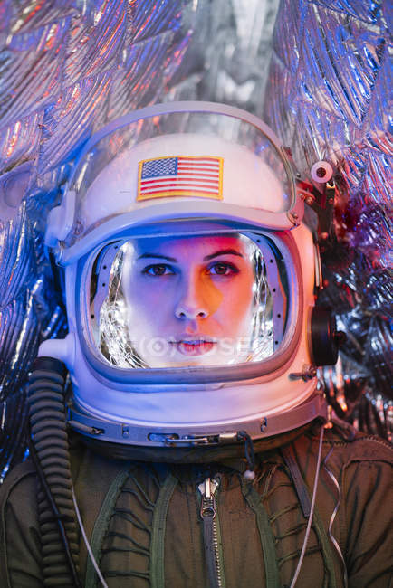 Close-up of female astronaut wearing old space helmet — Stock Photo