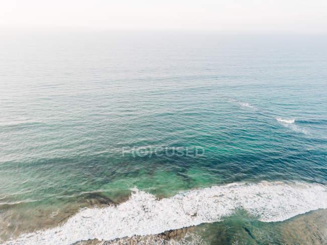 Ripple blue sea water surface near beach — Stock Photo