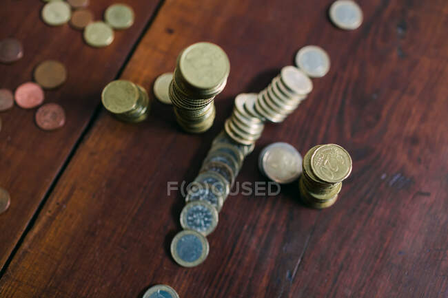 Shiny coins on table — Stock Photo