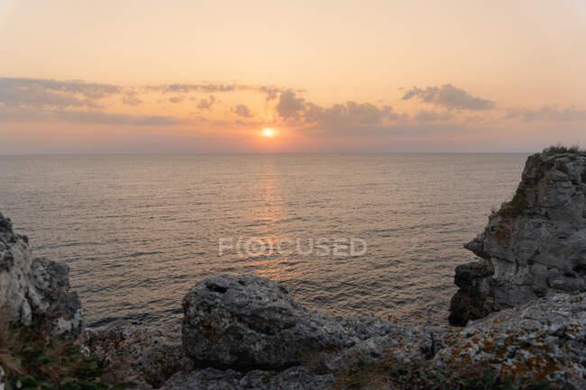 Amazing rough rocks standing in calm sea water during beautiful sunset in Tyulenovo, Bulgaria — Stock Photo
